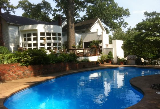 view overlooking pool of oakton va home transformed