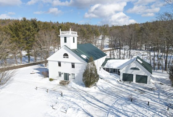 Aerial view of Historic Church Conversion on a country road