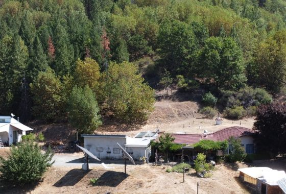 Aerial view of the earth-sheltered off grid home and acreage.
