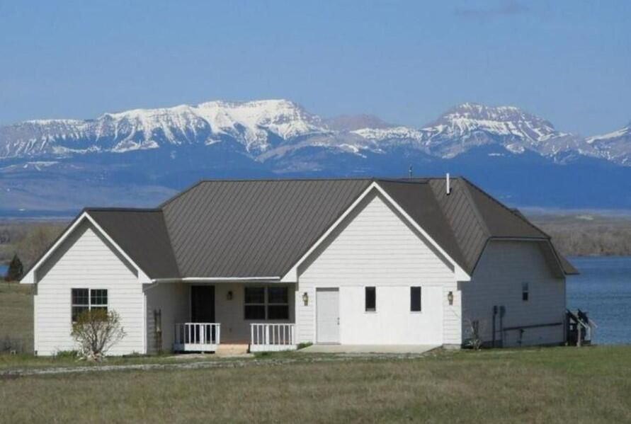 Views of the lake and mountains from this Waterfront Eureka Reservoir Home